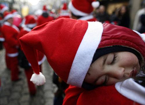 A child dressed as Santa Claus slept during a parade in the streets of Porto, Portugal, on Dec. 14.
