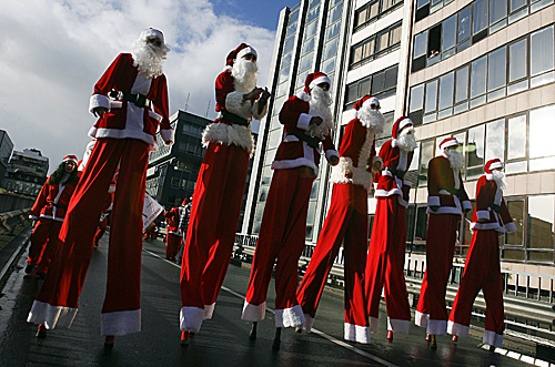 Santas on stilts walked in the annual Santa Claus parade on Dec. 14 in Porto, Portugal. Thousands took part in the parade in an attempt to break the Guinness record for most people dressed as Santa Claus.