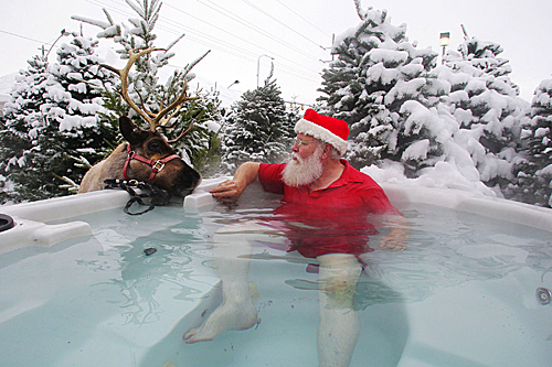 Santa escaped the snowstorm by relaxing in the hot tub at M & T Christmas Trees on Dec. 13 in Sandy, Utah.