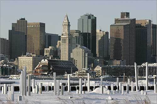 Construction was slowed on a Boston Harbor waterfront site after two major storms hit the area Friday and Sunday.