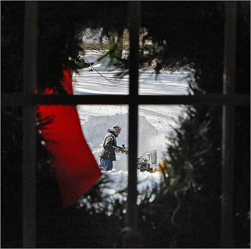 Bill Bennett of Methuen used his snowblower to clear the snow from his driveway Monday.