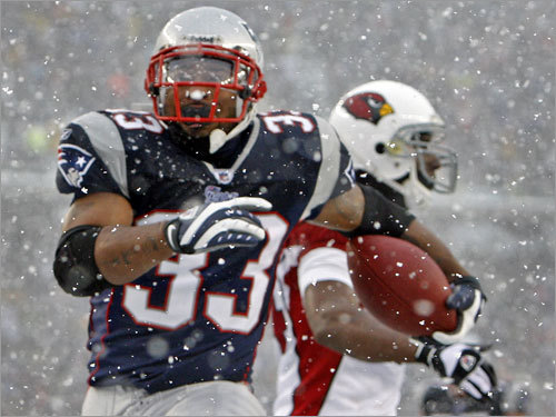 Patriots running back Kevin Faulk high steps through the snow into the end zone as he scores a second-quarter touchdown.