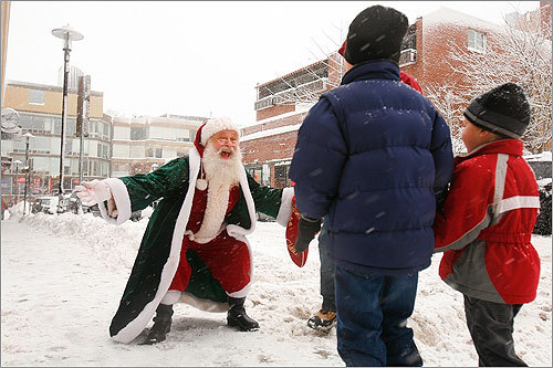 John, 7, and Karstan Steinke, 4, were greeted by Santa Claus on Sunday when they attended Sparklefest 2008, an event put on by the Harvard Square Business Association.