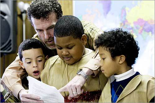 Burton Bagby helped Louis Colon, 8, Quante Sanderclark, 7, and Daniel Abdulah, 7, during The First Baptist Church's Christmas Pageant, performed by children of the congregation in Jamaica Plain on Dec. 21.