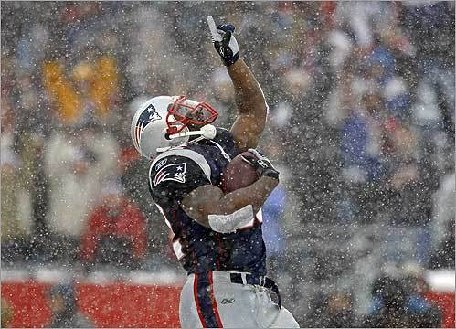 Patriots running back LaMont Jordan celebrated after he scored touchdown in the first half of New England's game against Arizona in Foxborough on Dec. 21. The Patriots won, 47-7.