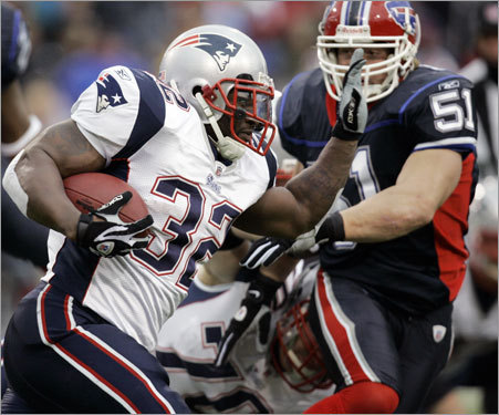 Patriots running back LaMont Jordan ran under pressure from Buffalo's Paul Posluszny (51) during the first half.