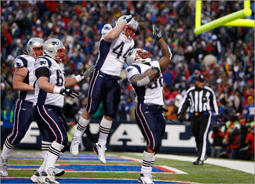 Patriots FB Heath Evans celebrated as Patriots running back LaMont Jordan scored the only touchdown of the game in the third quarter.