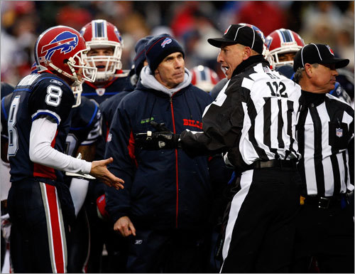 Bills head coach Dick Jauron and Bills punter Brian Moorman question the officiating crew after time ran out with the Bills unable to get a field goal off late in the 2nd quarter.