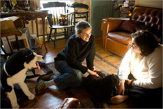 Laura Eisenmann (center) and her daughter, Sarah, spend a quiet day at their Winchester home. Laura says her employer, Ernst & Young, is very supportive of special needs parents.