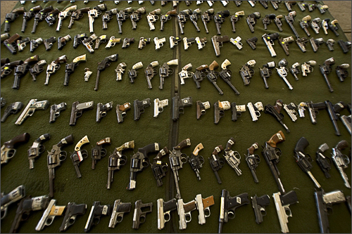 Weapons are displayed before being destroyed by the Mexican Army in Tijuana, Mexico, on December 30, 2008. The Mexican Army collected 1,932 weapons, 70 grenades, and 2,131 cartridges, turned in voluntarily by citizens as part of a campaign to remove weapons from the streets in Baja California State.