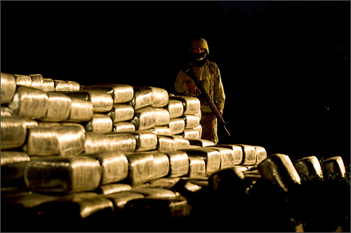 A Mexican soldier guards packages containing marijuana that are displayed for the media in Tijuana, Mexico on December 5, 2008. Soldiers seized about 297 packages containing some 1663 kg of marihuana, found hidden in a truck, during a routine inspection at a check point on the road between the cities of Ensenada and Rosarito, some 25 miles south of Tijuana.