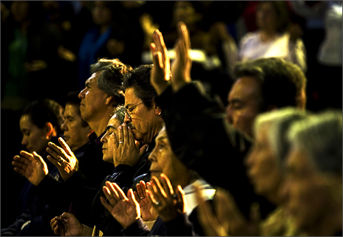 People pray during a special service against violence in Tijuana, Mexico on November 26, 2008. Members of different religions, relatives of kidnapped people and community members gathered to pray for peace and against the violence hitting this border city.