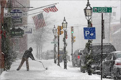 A lone shoveler braved wind and heavy snow on State Street in Newburyport on New Year's Eve.