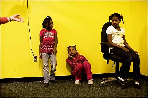 Khy-asia Davis (left), 6, Shaunice Stanley, 8, and Nydea Franklin, 8, rehearsed a play for First Night with the Andrea Lovett Storytelling Ensemble at the Franklin Park Development Association on Seaver Street in Boston on Dec. 29.