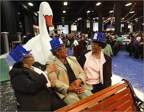 Friends for more than 20 years, Constance Claiborne (left), Fannie Banks, and Cathy Arrington, on a Swan Boat replica, were among more than 3,000 seniors celebrating the Seniors First Night at the Seaport World Trade Center on Dec. 30.