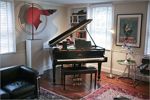 A closer look at a piano in the living room.
