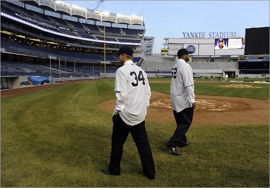 A.J. Burnett (34), no longer a Blue Jay, and C.C. Sabathia (52), no more a Brewer, inspect their new professional work space in the Bronx last month, the brand-new Yankee Stadium.