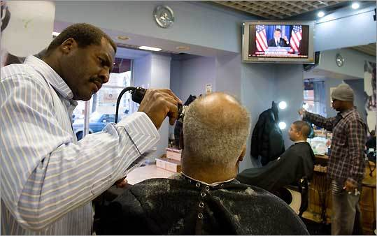 The Obama is the most popular cut at Hyde Park Hair Salon, which is owned by a stylist known as Zariff (left).