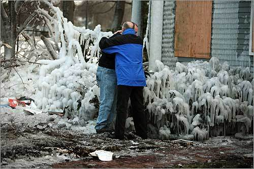 Steve Crosby (right) comforted his step-son Sam Linsky on Jan. 6, after the Los Angeles resident brought out burnt pages of his 1988 high school yearbook. Crosby's home at 83 Penniman Place in Brookline, listed on the National Register of Historic Places, was destroyed in a fire on New Year's Eve.