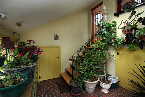 Down a short set of stairs from the great room is a gardening nook with access to yard.