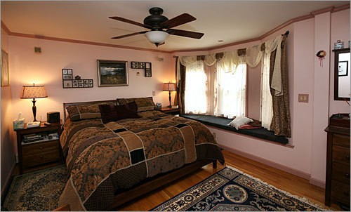The master bedroom suite is ample, has a walk-in closet and its own bath and marble clad shower.