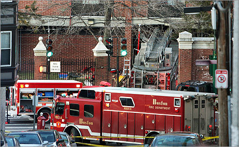The ladder truck was partially visible in the front of the building at 835 Huntington Ave.