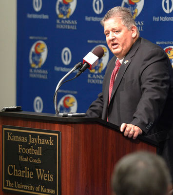 Charlie Weis The innovative offensive coordinator left after the 2004 season to take the head coaching job at Notre Dame. No formal replacement was named for the 2005 season, but Josh McDaniels took over as offensive coordinator in 2006. Things did not go smoothly for Weis at Notre Dame: After a successful debut , he was rewarded with a 10-year extension, but when the program didn't progress, he was fired with six years remaining. Weis was named the offensive coordinator for the Kansas City Chiefs in 2010, then served as the offensive coordinator for the Florida Gators during the 2011 season. In December 2011, the 55-year-old Weis was hired as the head coach for the University of Kansas.