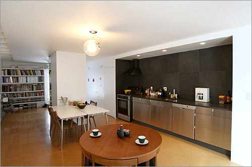 The long, narrow kitchen has a backdrop of slate.