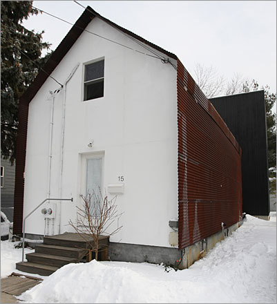 Look at the front of this 19th-century worker's cottage and it might be a chapel, gleaming white in the winter sun. Address: 15 Clifton St. Price: $539,000 Style: Postmodern Built: 1894 Square feet: 1,434