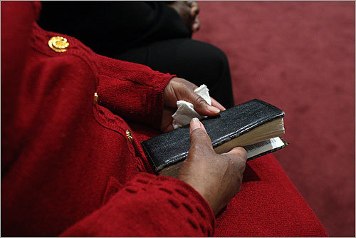 Sylvia Grimes held her bible and tissue during Monday morning church services at her group's sister church.