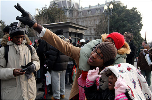 Tramayne Willams, with daughter Tanija (on his back) and Jalia (with blanket) tried to get a view of the Blair House where President Elect Barack Obama was on Monday.