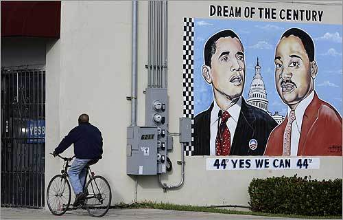 A cyclist rode past a mural showing Obama and King side by side in the Miami neighborhood of Liberty City on Monday.