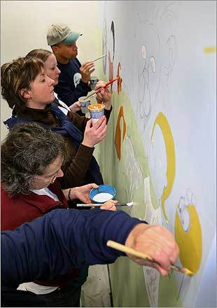 Volunteers working on a mural in Roxbury Community College's day-care center Saturday were (from top) Governor Deval Patrick, Beth Barrett, Myriam Thurber, Rose Bathalon, and Quinin Velez.