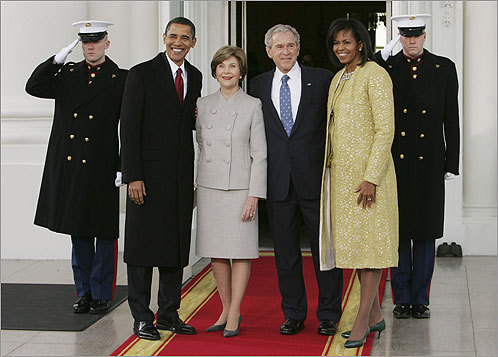 Bush and first lady Laura Bush greeted Obama and his wife, Michelle, in front of the White House.