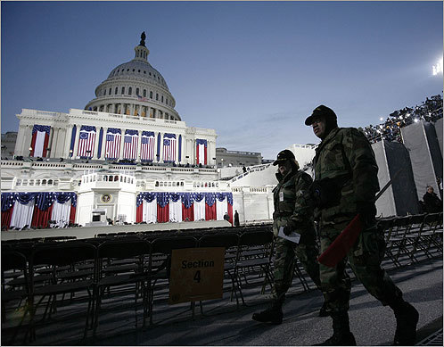 Soldiers walked in front of the Capitol Building hours before the inauguration as a security measure.