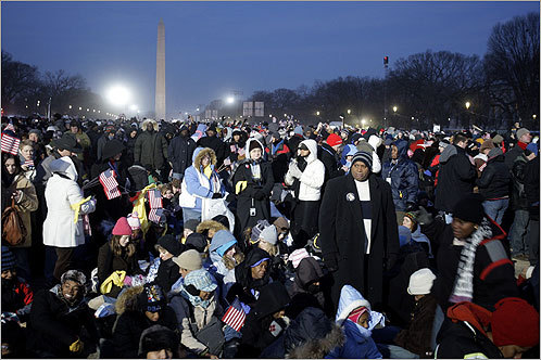 Hordes of spectators waited hours before the swearing-in ceremony, bundled up to combat the cold January weather.