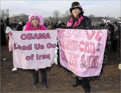 Medea Benjamin and Desiree Fairooc of Arlington, Texas, held up signs supporting the withdrawal of troops from Iraq.