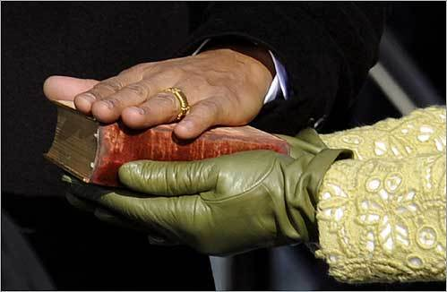 Obama placed his hand on Abraham Lincoln's Bible as his wife, Michelle, held the Bible during the swearing-in ceremony.