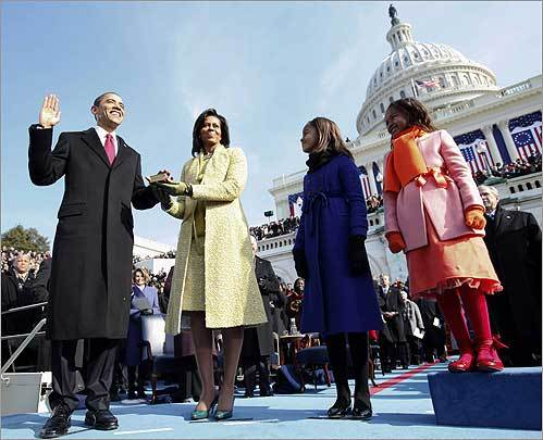 Obama took the Oath of Office with the US Capitol in the background.