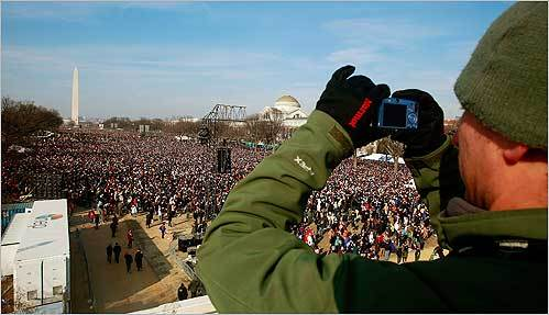 A man took a photograph of the crowd gathering on the National Mall.