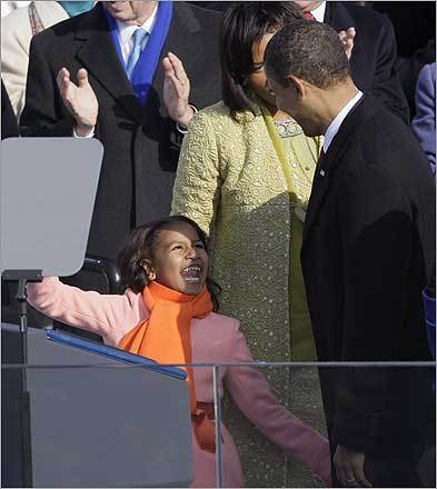 Sasha Obama, left, laughs with her father, President Obama, following his inaugural address.