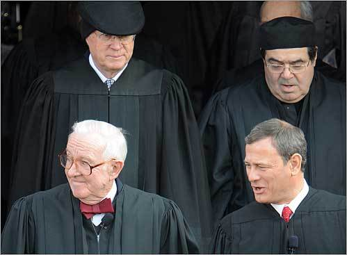 Supreme Court Chief Justice John Roberts, right, led justices out for the inauguration ceremony. Also shown are Justices John Paul Stevens, left, Anthony Kennedy, behind left, and Antonin Scalia.