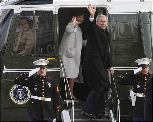 Former President Bush and Laura Bush waved goodbye as they boarded a Marine helicopter at the Capitol.
