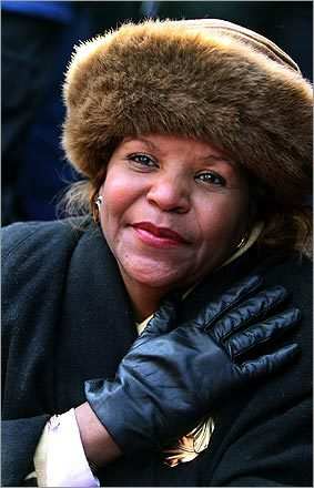 Theresa Gee of Richmond, Va. listened to one of the musical selections during the inauguration ceremonies.