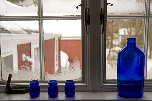 Bottles sit on a window ledge in an upstairs bedroom.