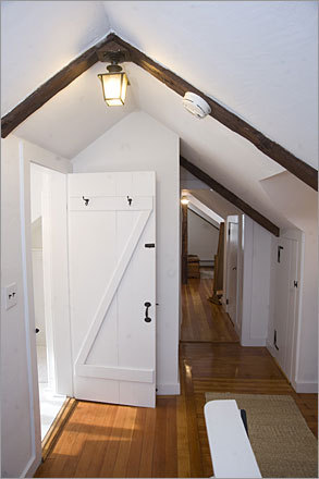 An upstairs hallway has built-in closets. The house is brighter than many Colonials, thanks to its southern exposure and unusually high ceilings (8 1/2 feet).