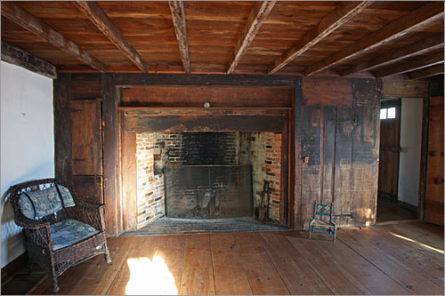 A huge fireplace sits in the south parlor.