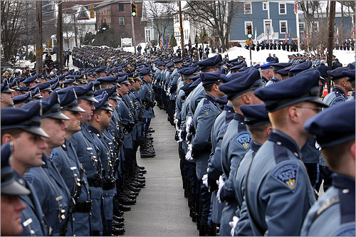 State troopers lined up at Sacred Hearts Church in Haverhill today for the funeral of State Police Captain Richard J. Cashin. Hundreds of officers from around the region, and mourners from as far away as California, paid their respects at the funeral.