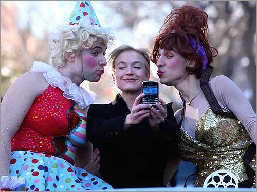 Renee Zellweger takes a photo of herself being kissed by David Andersson, president of Hasty Pudding Theatricals, and Tom Compton, VP of the cast.