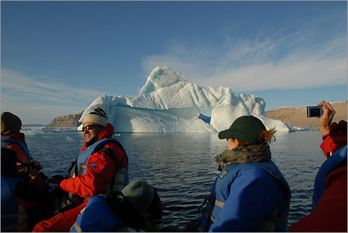 Off the ship and on a Zodiac, passengers get closer to an iceberg in Dundas Harbour.